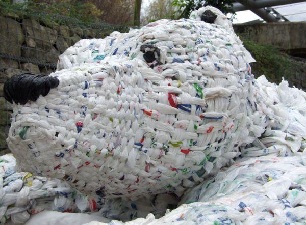 Polar bear sculpture consists of plastic bags,