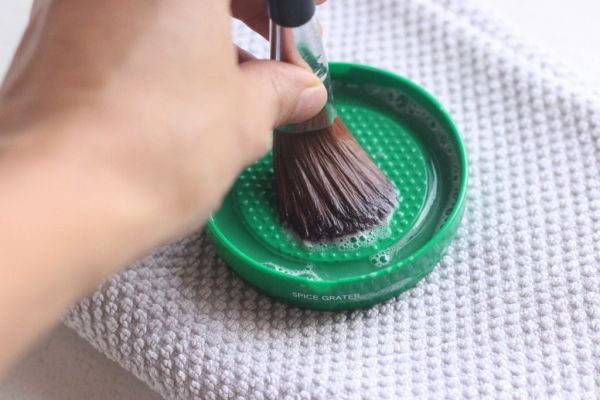 Clean make up brushes with spice grater