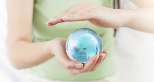 Earth Globe in Human Hands