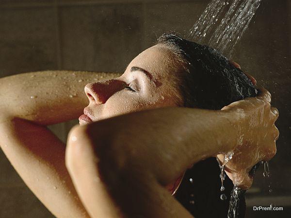 beautiful woman in a shower washing her hair