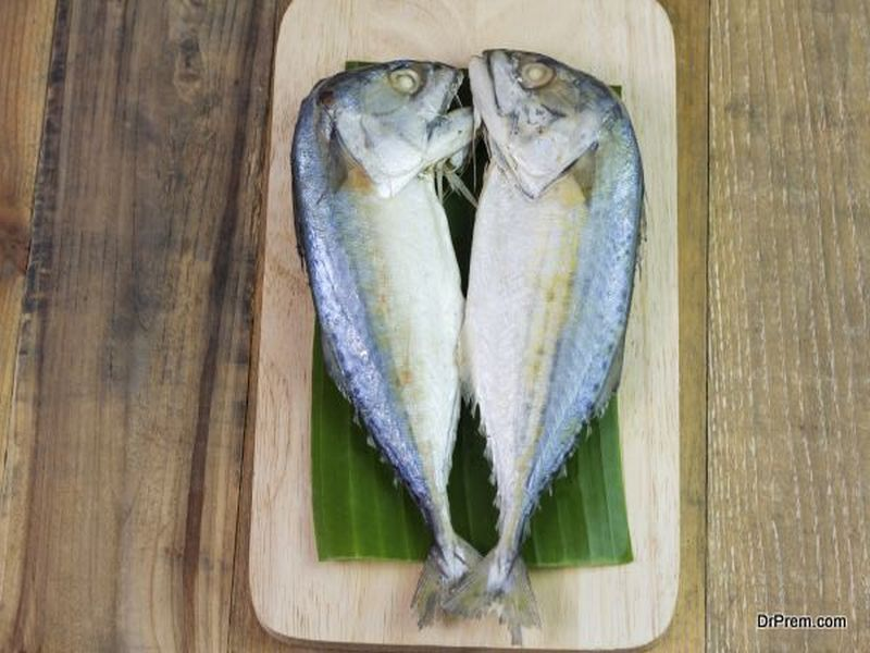 Steamed mackerel or tuna steamed on wooden background