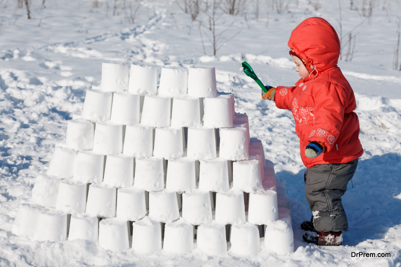 child making snow castle