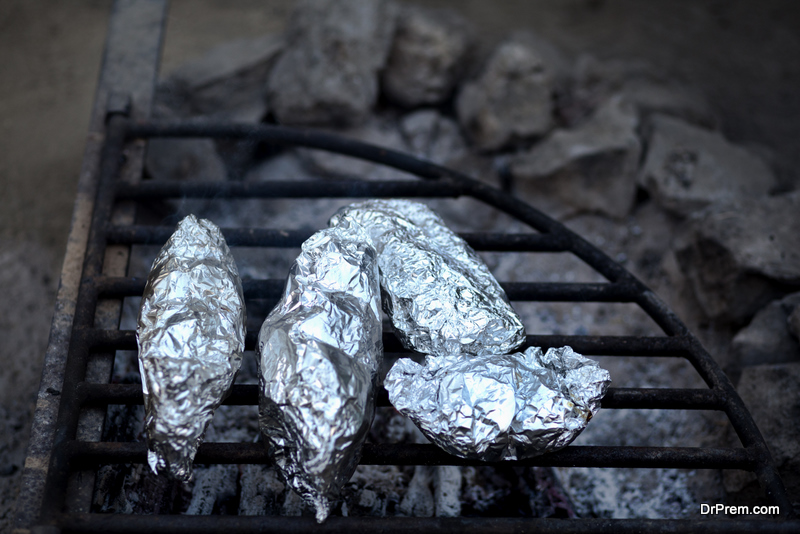 Cooking food in foil on a camping trip